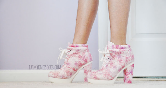 More modeled photos of the pink floral-print white lace-up high-heel platform booties from AMIClubwear.