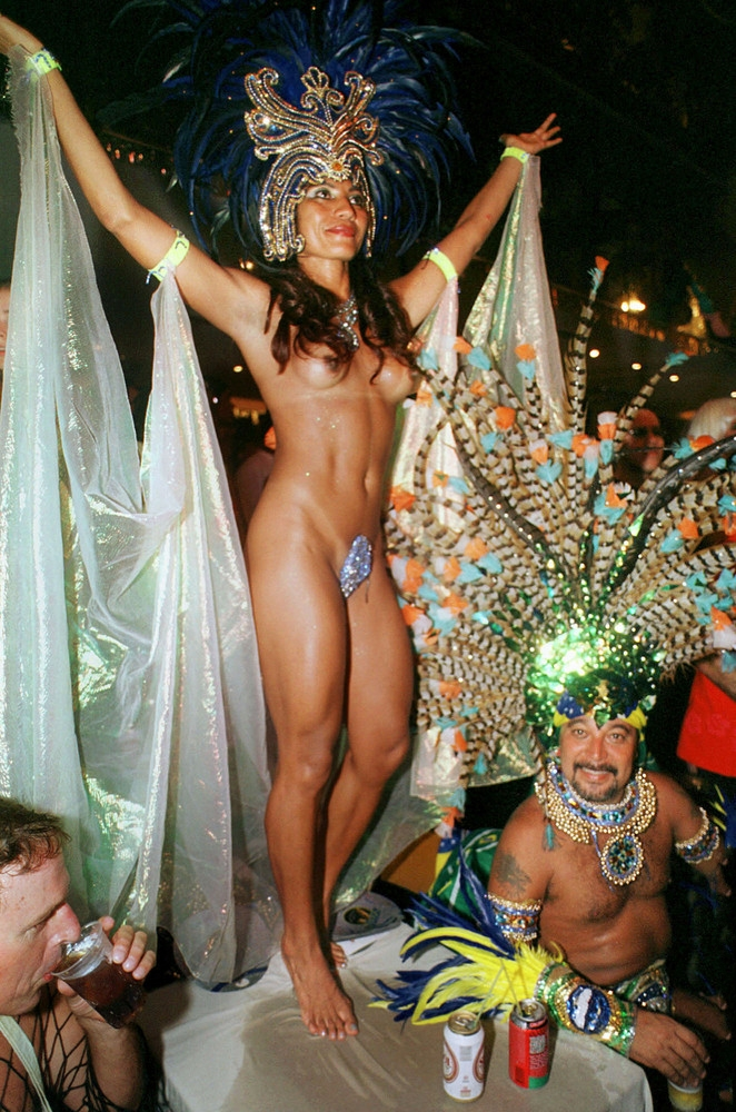 A woman dances on a table at one of the gay balls on the last night of Carnival festivities February 13, 2002 in Rio de Janeiro, Brazil.