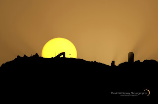 Sun setting behind Kitt Peak with transiting Venus