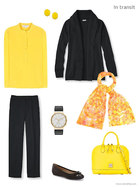 travel outfit in yellow and black, with a yellow silk blouse, yellow handbag and black cashmere cardigan