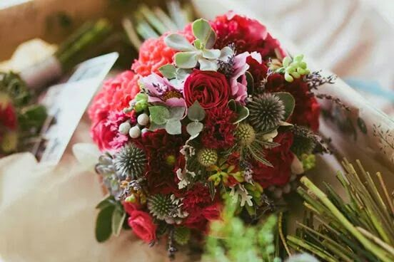Bright vintage wedding bouquet by Sheffield florist Campbell's Flowers.