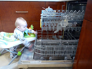 Freddie unloads the dishwasher