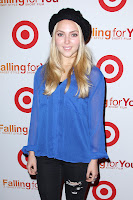 AnnaSophia Robb wearing ripped jeans and blue top