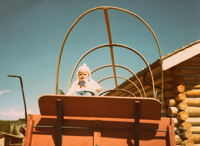 baby claire in a covered wagon in wyoming