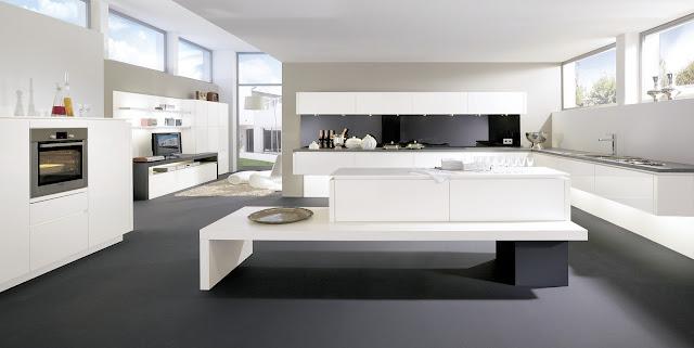 cuisine design avec îlot original composé par ALNO. La cuisine est ouverte sur une composition de salon moderne