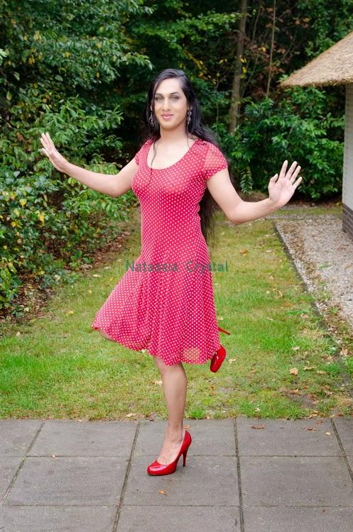 Natassia Crystal natcrys, red polka-dot dress, outside balancing one leg stand