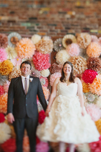 wall covered with pompoms photo backdrop