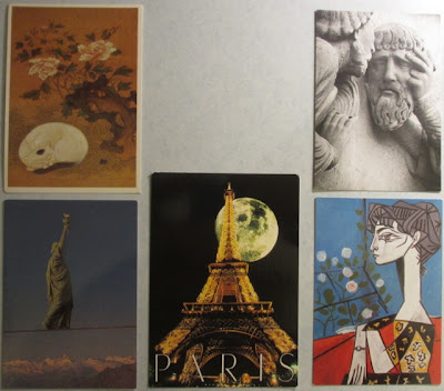 5 postcards: cat, Paris, Picasso, etc.