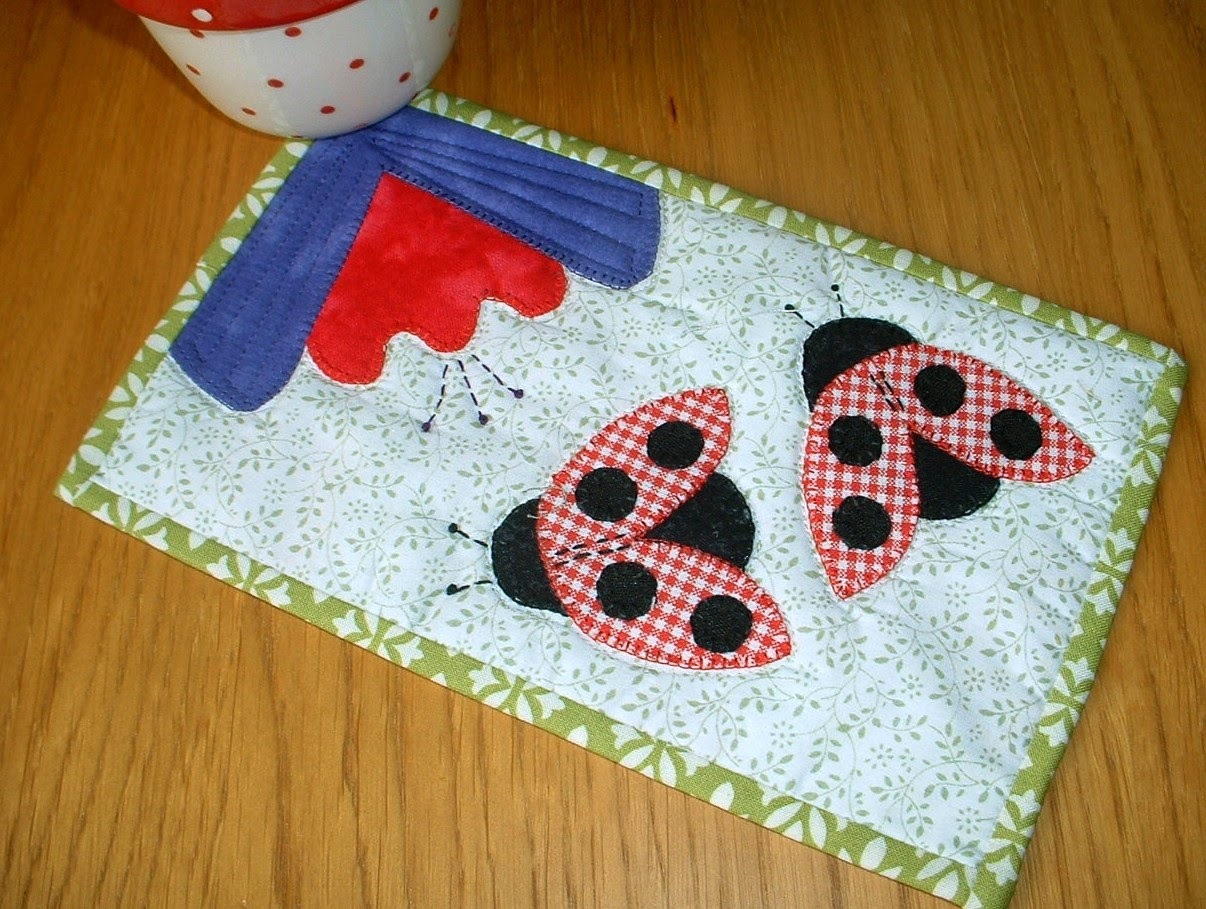 http://www.craftsy.com/pattern/quilting/home-decor/ladybugladybird-mug-rug/57620