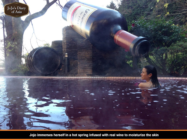"Jojo immerses herself in a hot spring infused with real wine to moisturize the skin - ""Jojo's Diary of Asia"""