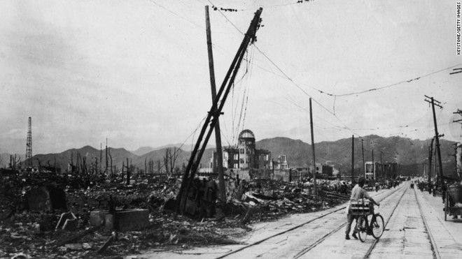 20 Shocking Pictures Of Hiroshima, The First City In History To Be Destroyed By An Atomic Bomb - A man on a bike crossing the destroyed Hiroshima, a few days after the first atomic bomb was dropped.