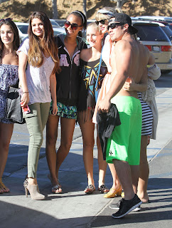 Selena Gomez and Taylor Swift on the parking lot in MAlibu taking pictures with fans