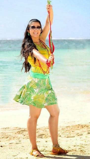 charmy kaur in nice skirt on beach dancing besides water hot pics free download hot pics