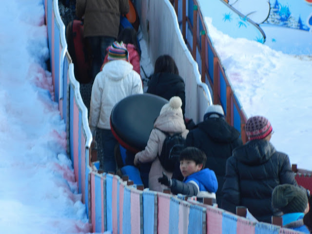 Climbing up to slide at Ttukseom Park, Seoul