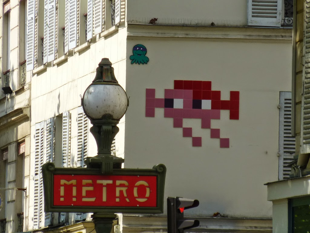 Constantly busy on the streets of his hometown, Paris, France, Invader just finished working on this pink and red Invasion.