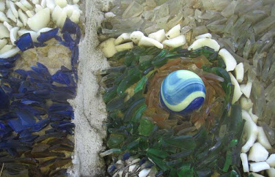 Circular elements with a blue on blue swirly marble