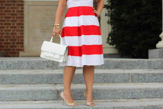 red and white striped dress and white structured bag