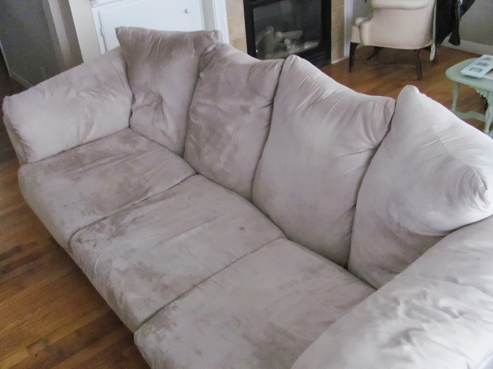 The couch is seen at an angle before being sold on Craigslist