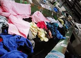piles of clothing to recycle