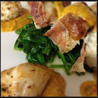 Monkfish wrapped in prosciutto with scallops, wilted spinach and tomato & basil sauce