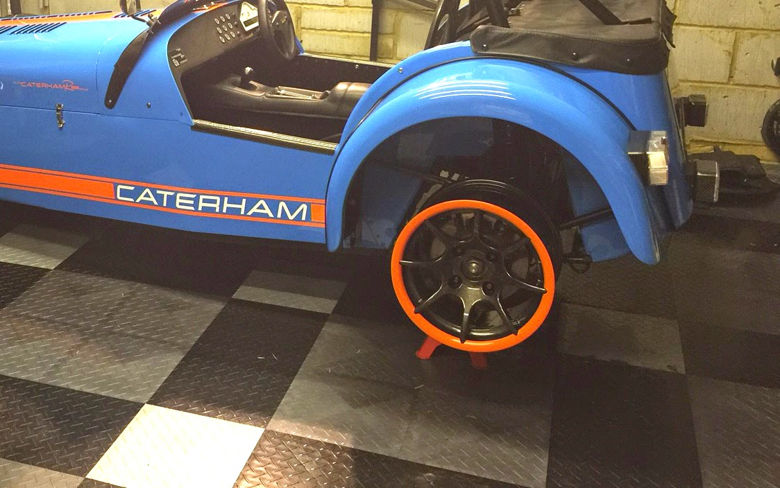 Wheel with orange rim test fitted