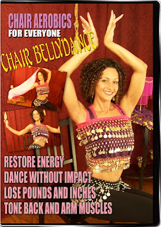 "The cover of the Chair Aerobics for Everyone: Chair Bellydance dvd.  Has a long, curly haired woman sitting down on the cover with a coin scarf tied over her sports bra, coin scarf on hips, black pants, arms overhead. Text reads ""restore energy, dance without impact, lose pounds and inches, tone back and arm muscles"""
