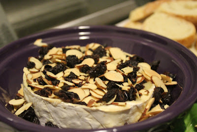 Baked Brie with toasted almonds and dried cherries