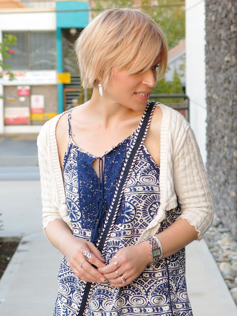 peasant-style tank top, cable-knit shrug, and accessories