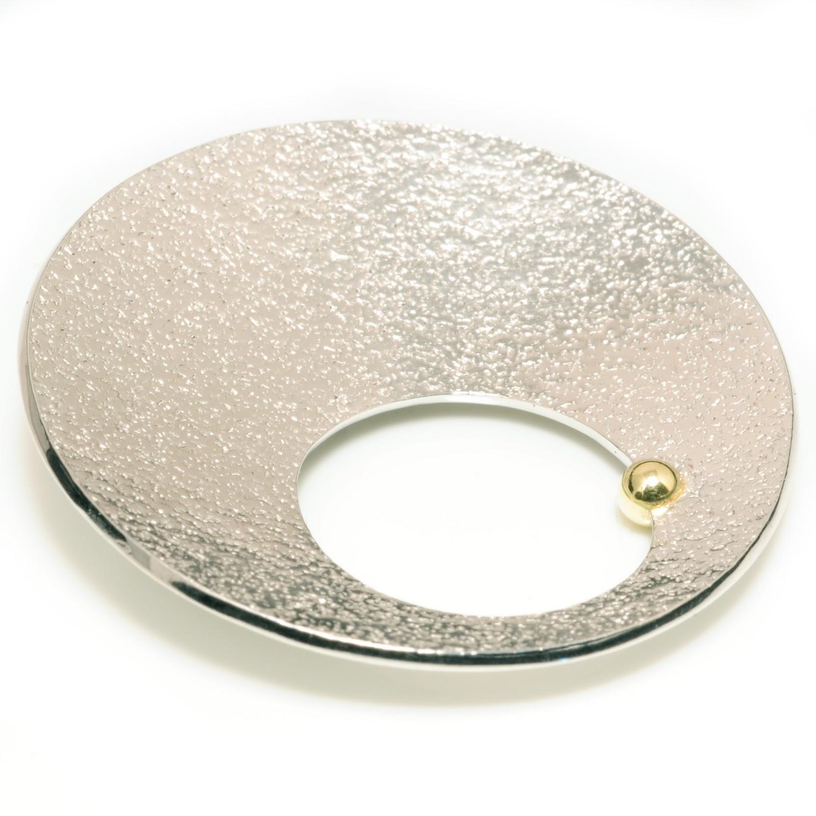 http://www.notonthehighstreet.com/machidewaardjewellery/product/gold-ball-concave-textured-brooch