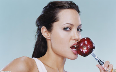 angelina jolie enjoying a tasty apple
