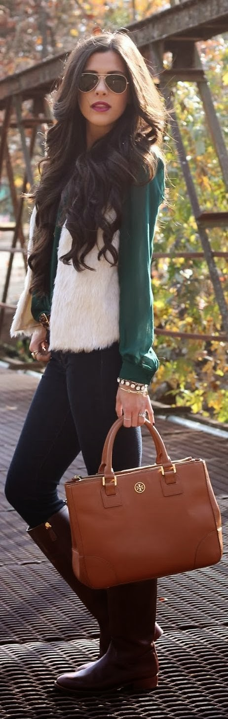 White sleeveless jacket, green blouse, skinnies and long tan boots with brown handbag