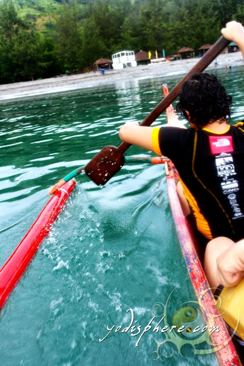 Banca rowing against the calm waters of Silnaguin Cove in Zambales  hover_share