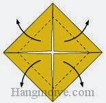 Bước 3: Gấp chéo bốn góc của lớp giấy trên cùng ra phía ngoài.