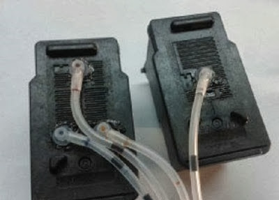 ink cartridges connected to hoses