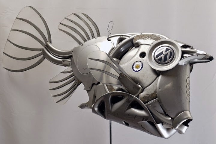 Cool  scrap metal and car wheel trims which he re shapes into a variety of life forms Out of these creatively re cycled sculptures fish sculptures are
