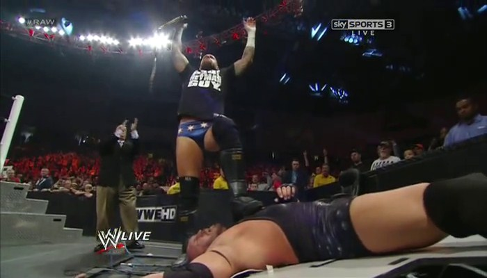 CM Punk standing over Ryback.