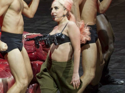 Lady Gaga wearing  gun bra