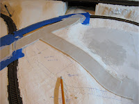 First layer of Woodland Scenics Smooth-It road plaster