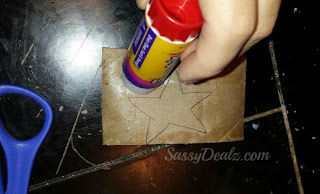 glue wonder woman star on cuffs