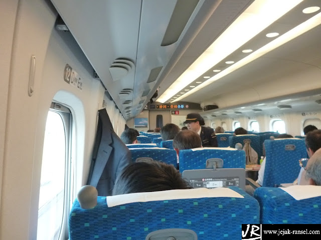 """Shinkansen on board, checking ticket by cabin crew"""