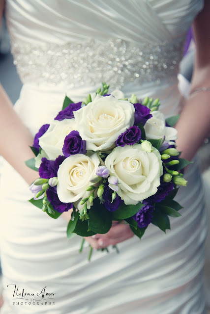 bride holding her white and purple roses bridal bouquet