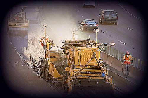 Paving crew working on a highway.
