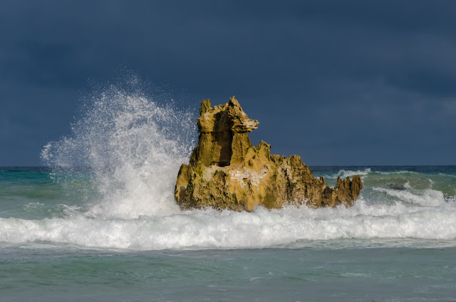 waves breaking on shipwreck rock