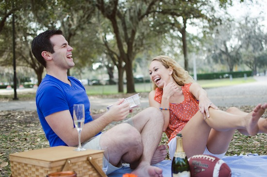 couple on a picnic and laughing