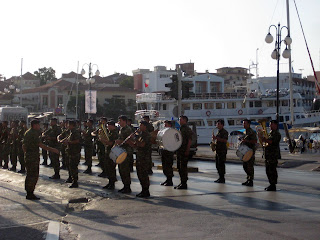 A Greek military band playing on the street in the morning.
