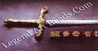The Sword of State, 1678, has a steel blade and a wooden velvet-covered scabbard decorated with silver-gilt motifs including the fleur-de-lys, harp, thistle, Tudor rose, portcullis and the royal arms of William III.