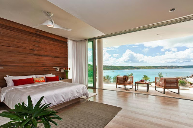 Another modern bedroom with wooden wall and a balcony