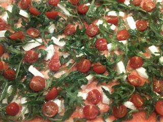 Cocina con Aníbal Pizza de rúcula y tomates cherry