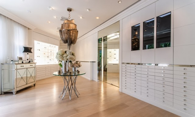 Walk in closet/dressing room in Celine Dion's home with mirrored dresser and built in storage