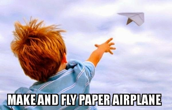 kid flying paper airplane
